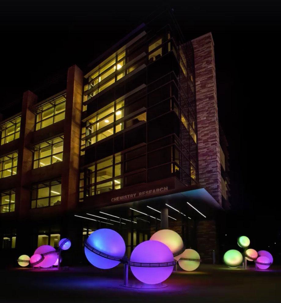 lit up molecular art at night