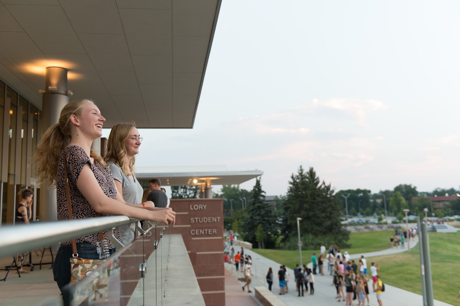students on the lory student center west balcony