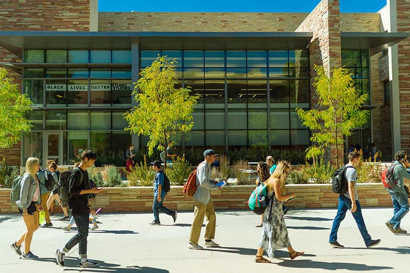 students walking in front of eddy building
