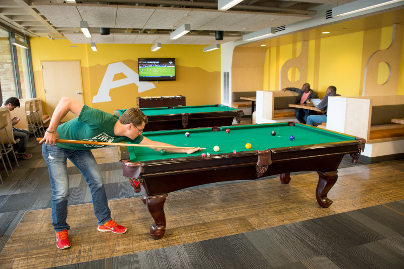 students playing billiards in the durrell center