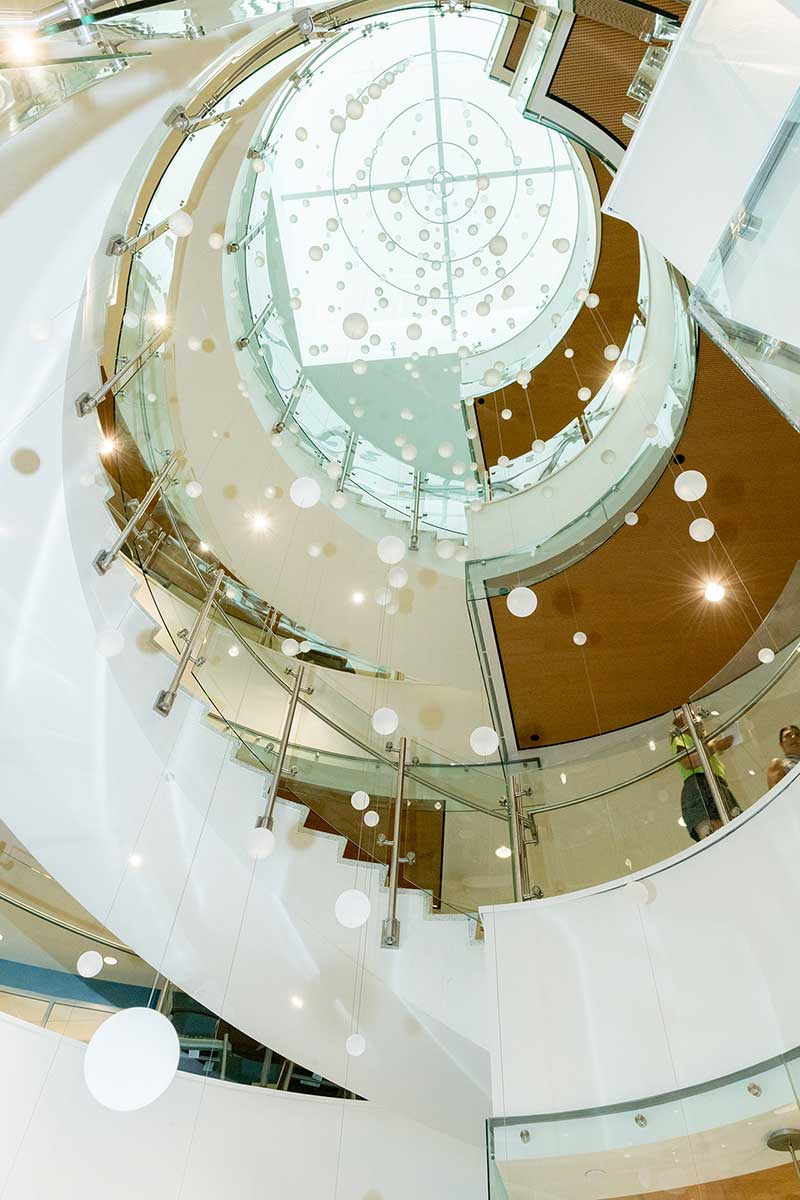looking up at hanging atrium directions in health and medical center