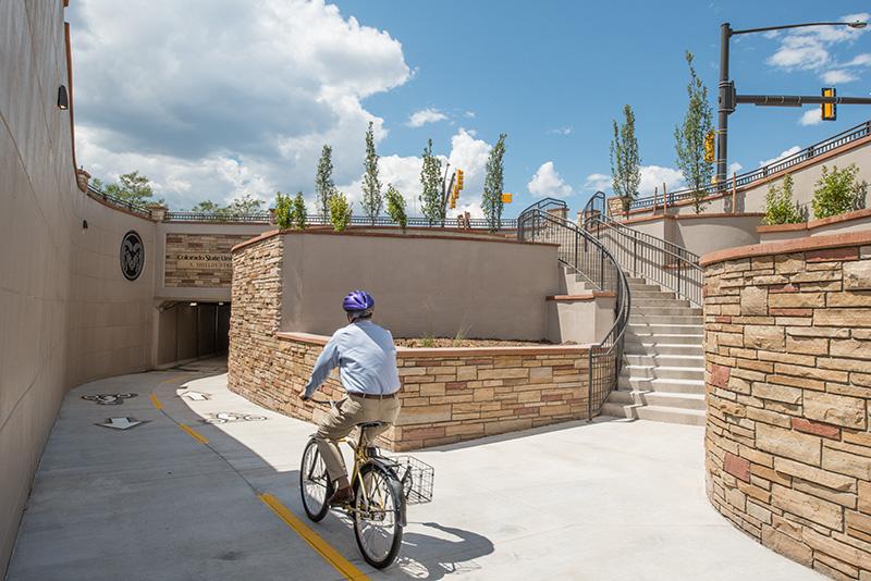 man riding bike at shields street underpass