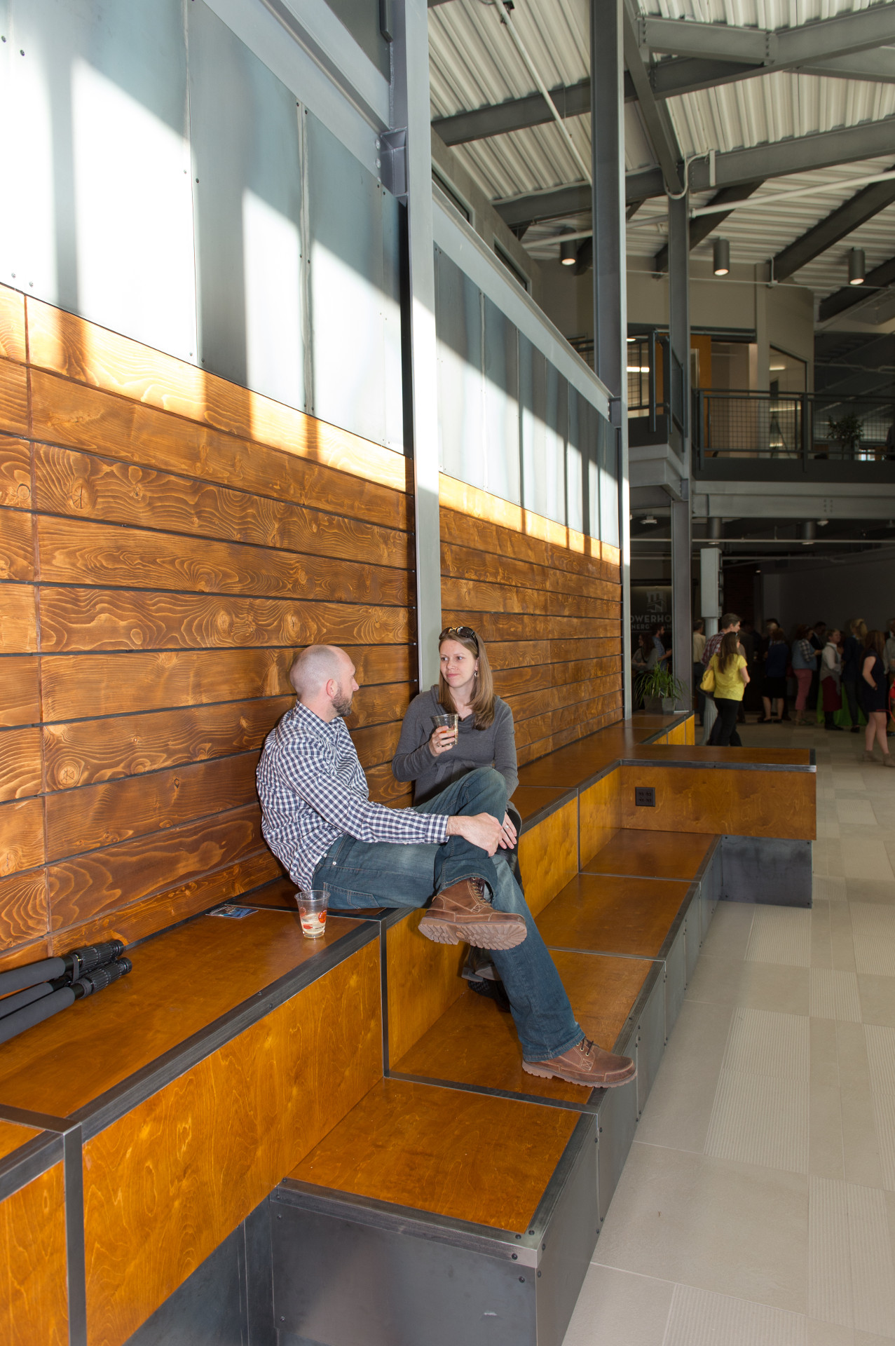 two people talking in powerhouse foyer