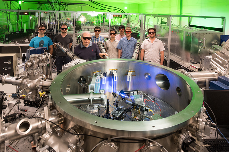 research team posing with laser
