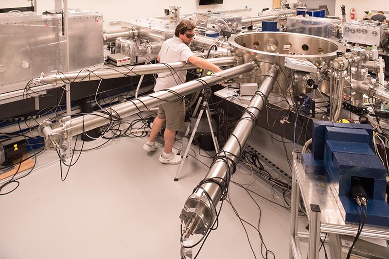 csu student workin on laser