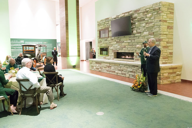 Michael Smith and Dr. Tony Frank speaking in the Iris and Michael Smith Alumni Center